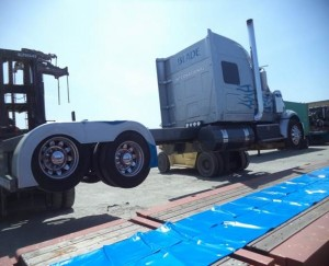 lifting truck onto flat rack