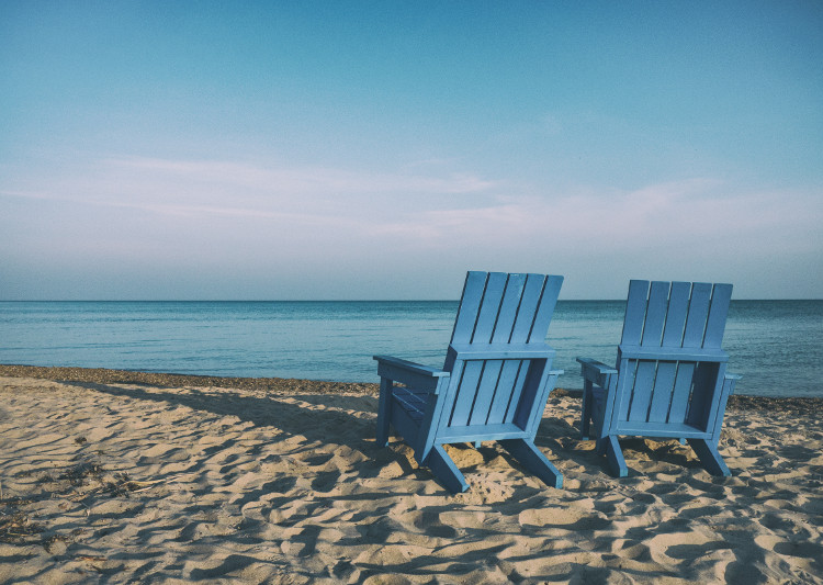 pair of chairs on a beach